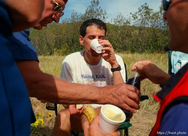 Mike Topper (center) drinks Dr. Pepper while Arhie Freitas (left) and Kevin Rumon (right) crew . At the Lambs Canyon aid station. Wasatch 100 Endurance Run.