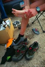 Dave Tavernini wipes his feet at the Lambs Canyon aid station. Wasatch 100 Endurance Run.