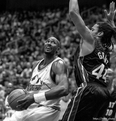 Karl Malone looks to shoot over Brian Grant at Jazz vs. Miami Heat.
