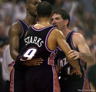 Bryon Russell and John Stockton hold back a piss-off John Starks as the Utah Jazz face the Dallas Mavericks in game four of their first round playoff series, in Dallas Tuesday. 05/01/2001