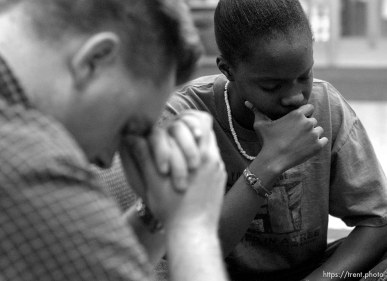 Four University of Utah students gathered to pray to God for the safety of the United States of America Tuesday night, approximately twelve hours following the world's worst terrorist attack. Red Shirt: Ryan Kimble, Blue Shirt/White Necklace: Alexandria Nash. 09/11/2001, 7:23:36 PM