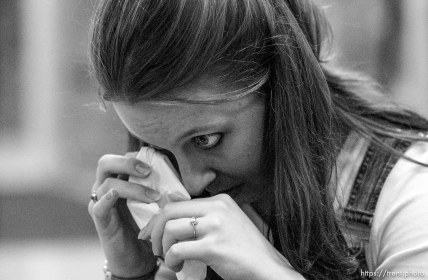 Liz Brooks wipes away a tear. Four University of Utah students gathered to pray to God for the safety of the United States of America Tuesday night, approximately twelve hours following the world's worst terrorist attack.. 09/11/2001, 7:27:00 PM