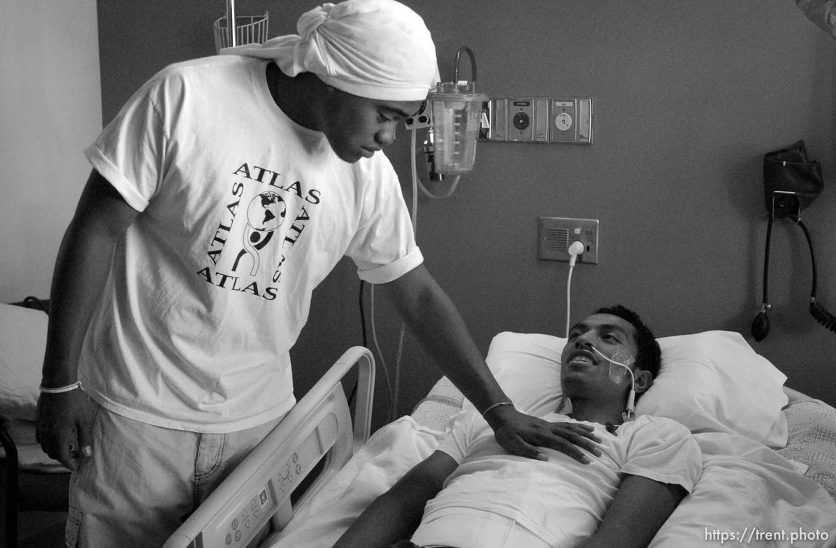 Siaosi Vainuku, a teammate of Una Taufa's at West High School, reaches out to touch his chest during a visit to LDS Hospital. West High football player Una Taufa suffered a severe neck injury in a game two weeks ago and is partially paralyzed. He has begun the long and arduous rehabilitation process at LDS Hospital.. 09/27/2001, 12:03:53 PM