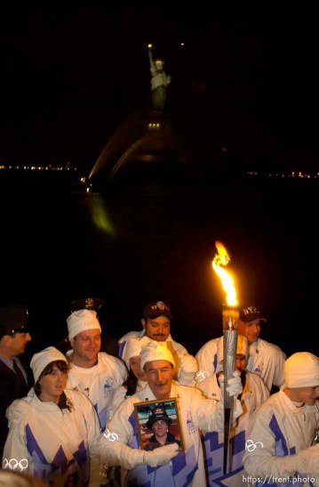 The Olympic Torch commemorates victims and heroes of the World Trade Center attack on a boat near the Statue of Liberty, then proceeds to Rockefeller Plaza where Mayor Giuliani carried the final torch and lit the Olympic cauldron. 12.23.2001, 5:40:24 PM