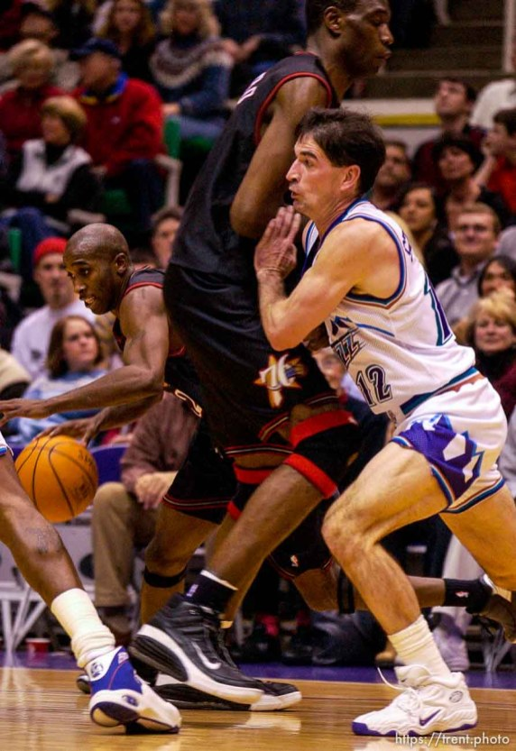 John Stockton fights through a pick. Jazz host the Philadelphia 76ers Saturday night at the Delta Center. Jazz win. 12.29.2001, 9:27:20 PM