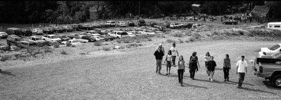 People walking up from parking lot. Llama Festival