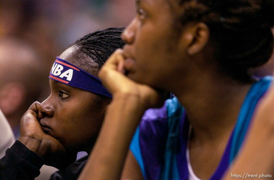 Utah's Marie Ferdinand (left) and Andrea Gardner watch from the bench near the end of Utah's loss to Los Angeles. Los Angeles Sparks vs. Utah Starzz, game two, WNBA playoffs. 08.24.2002, 3:51:46 PM