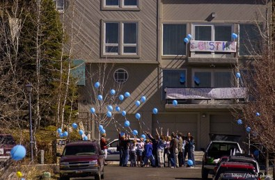 Elizabeth Smart celebrates her missed birthday with her cousins, who hold balloons , then release them into the air.