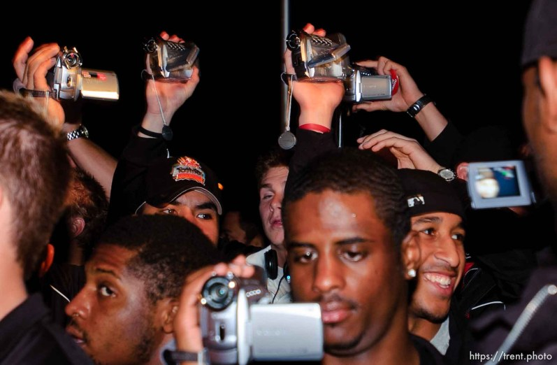 players with videocameras. The Utah football team and their Fiesta Bowl appearance was the focus of a large pep rally was held Thursday evening at the Point South Mountain Resort. A large crowd of Utah fans was joined by the school band and cheerleaders.