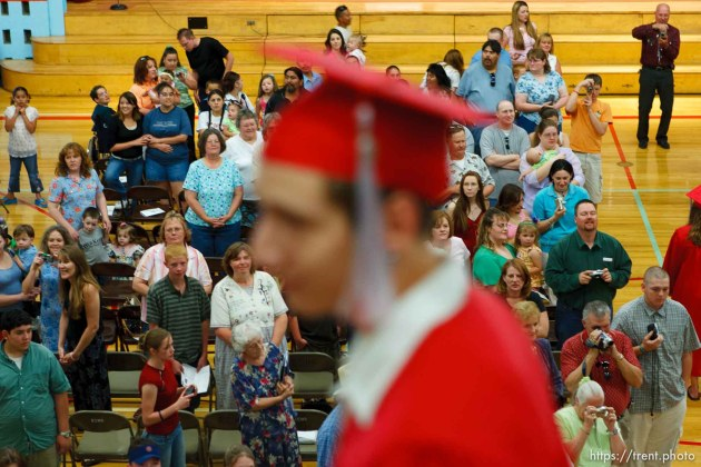Family and friends fill the East Carbon High School gymnasium as the class of 2005 graduation ceremony begins. Walking in the procession is Cody Valdez.