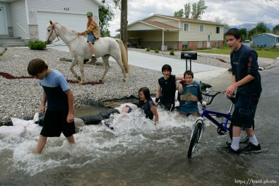 Kids playing in flood water. Flooding along 700 South in Tooele Tuesday.Todd Collins, Jeze Lords, Jesse Riddle, David Lords, and Daniel Lords