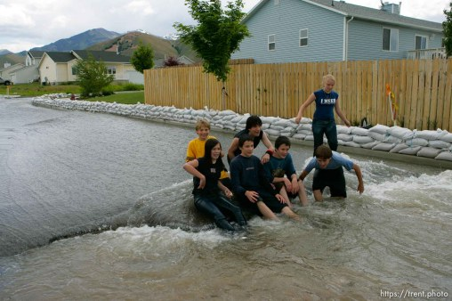Kids playing in flood water. Flooding along 700 South in Tooele Tuesday.