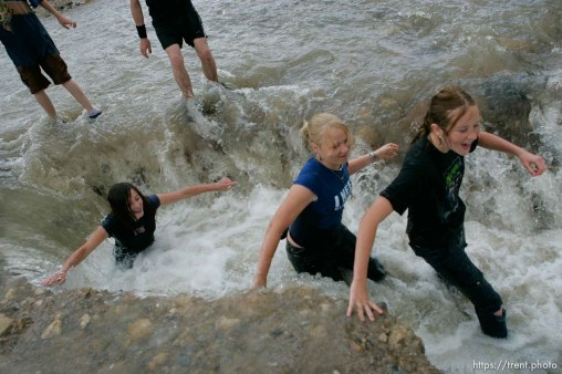 Kids playing in flood water. Flooding along 700 South in Tooele Tuesday. Jeze Lords, Kelsey Bringard and Amanda Hager