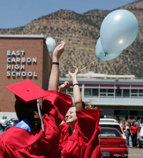 Stephanie Richens (facing) and her classmates released balloons following the final graduation at East Carbon High School.