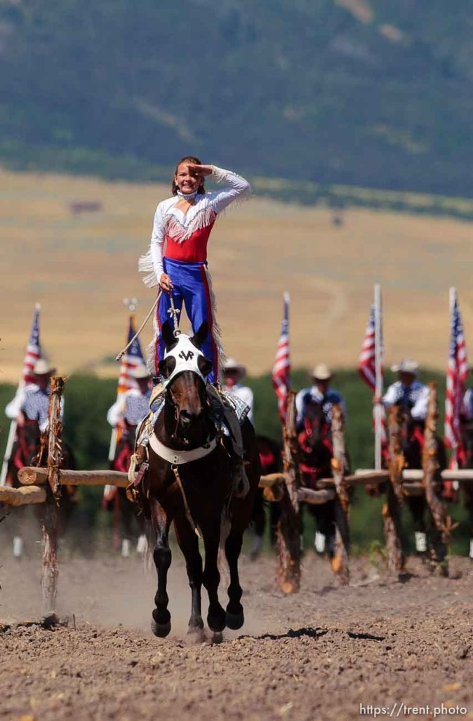 Paige Hadlock, a 12-year-old from Ogden, performs the Hippodrome Stand on her horse Jet as a Wild West Show kicks off the Festival of the American West at Wellsville's American West Heritage Center. 2005 National Cutting Horse Association Jr. Youth Western National Champion Paige Hadlock, a 12-year-old from Ogden.