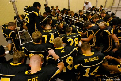 Cottonwood team prayer pre-game in the locker room. Cottonwood vs. Highland high school football.