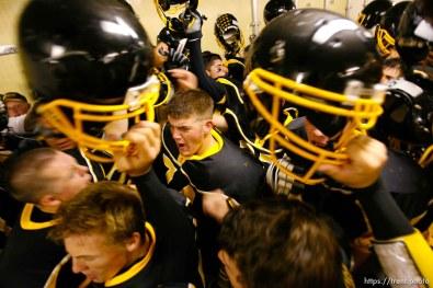 Cottonwood pre-game in the locker room. Cottonwood vs. Highland high school football.