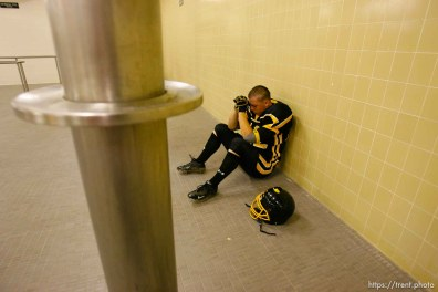 Cottonwood's Casey Riley prays pre-game in the locker room. Cottonwood vs. Highland high school football.