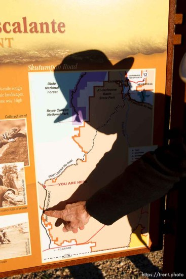 Kane County Commissioner Mark Habbeshaw points to a spot on a BLM map of the Grand Staircase National Monument. The BLM and Kane County have placed conflicting signs on roads in the area. Kane County's signs indicate OHV/ATV access, which the BLM disputes.