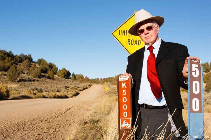 Kane County Commissioner Mark Habbeshaw at the intersection of Johnson Canyon Road and Skutumpah Road in the Grand Staircase National Monument, where the BLM and Kane County have placed conflicting signs. Kane County's sign (on left) indicates OHV/ATV access, which the BLM disputes.