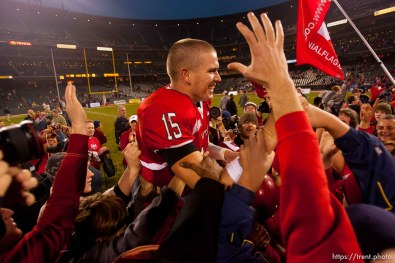Utah quarterback Brett Ratliff is lifted up by fans after the win. University of Utah vs. Georgia Tech, Emerald Bowl, San Francisco.