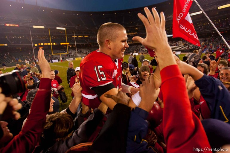 Utah quarterback Brett Ratliff is lifted up by fans after the win. University of Utah vs. Georgia Tech, Emerald Bowl, San Francisco.