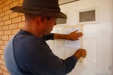 Andrew Chatwin posting tax notices to homes on UEP property.