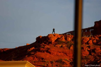 St. George - A law enforcement officer providing security for the Warren Jeffs hearing, watching the 5th District Courthouse from the top of a bluff with binoculars. Preliminary hearing, Warren Jeffs trial, 5th District Court.