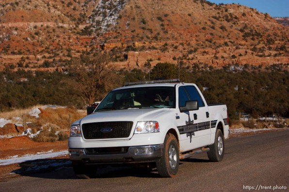 Hildale - A Marshal with the FLDS Hildale/Colorado City Town Marshals on patrol in Hildale, Utah.. for FLDS Hildale/Colorado City Town Marshal story; 12.20.2006