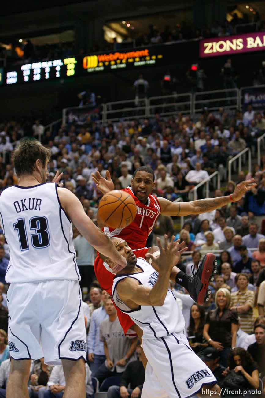 Salt Lake City - Utah Jazz guard Derek Fisher (2) knocks the ball away from Tracy McGrady (top). Utah Jazz vs. Houston Rockets, game 6, NBA playoffs first round. Jazz win 94-82