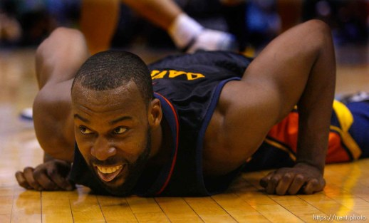 Salt Lake City - Golden State Warriors guard Baron Davis (5) picks himself up off the court after losing control of the ball in the third quarter. Utah Jazz vs. Golden State Warriors, NBA Playoffs basketball, second round, Game Two, at EnergySolutions Arena.