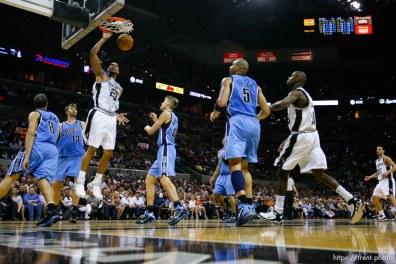 San Antonio - San Antonio Spurs forward Tim Duncan (21) dunks the ball, Utah Jazz center Mehmet Okur (13), of Turkey, defending. Utah Jazz vs. San Antonio Spurs, NBA basketball, Western Conference Finals Game One. 5.20.2007
