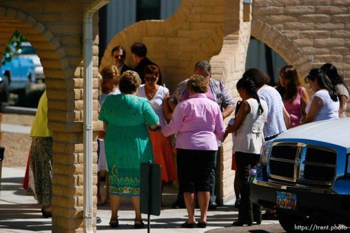 Huntington - Churchgoers form a prayer circle outside the San Rafael Mission before a mass led by Bishop John Wester for family members of the six trapped miners in the Crandall Canyon mine.
