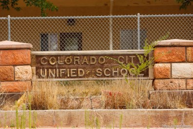 colorado city unified school sign with weeds