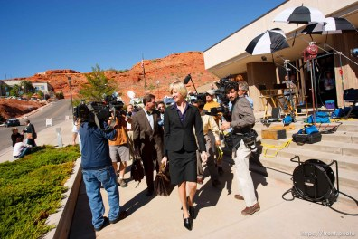 defense attorney Tara Isaacson, Walter Bugden and media. St. George - Warren Jeffs trial. The polygamous sect leader was charged with two counts of rape as an accomplice stemming from a marriage he officiated involving a 14-year-old girl and her 19-year-old cousin. photographer steve marcus