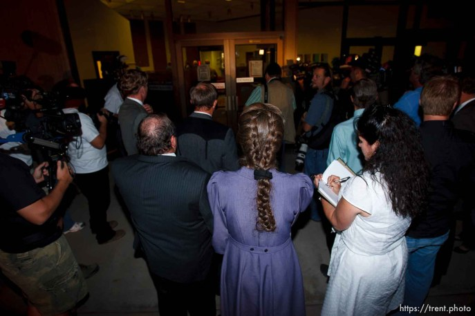 """FLDS followers of Warren Jeffs and woman """"journalist"""" blocking camera. St. George - Warren Jeffs trial. The polygamous sect leader was charged with two counts of rape as an accomplice stemming from a marriage he officiated involving a 14-year-old girl and her 19-year-old cousin."""