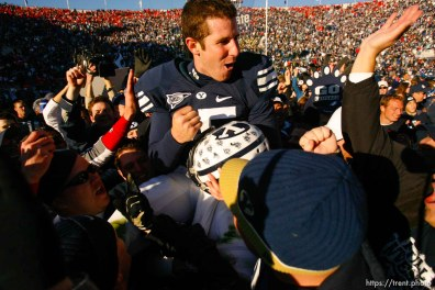 Provo - BYU fans hold Brigham Young quarterback Max Hall (15) on their shoulders, celebrating victory as BYU defeats the University of Utah 17-10 in college football action Saturday at BYU's Lavell Edward Stadium.