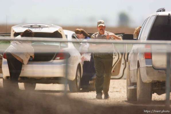"""Eldorado - Young FLDS woman with baby arriving at civic center during raid on the FLDS YFZ """"Yearning for Zion"""" compound outside of Eldorado, Texas, Saturday, April 5, 2008. CPS"""
