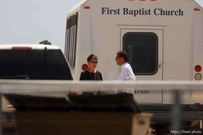 """Eldorado - CPS worker, first baptist church bus at civic center during raid on the FLDS YFZ """"Yearning for Zion"""" compound outside of Eldorado, Texas, Saturday, April 5, 2008. CPS"""