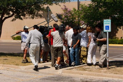 San Angelo - Attorney Jimmy Stewart is chased to his car by reporters as left a gathering of attorneys at the DFPS at the Ralph R. Chase building Sunday, June 1, 2008 to hammer out an agreement to return over 450 children that were taken from the YFZ ranch.