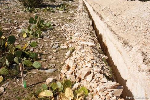 Eldorado - Tour of YFZ Ranch Thursday, June 26, 2008. sewer line cut in rock