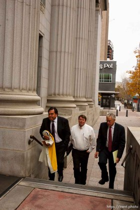 Salt Lake City - Salt Lake City - FLDS members enter the Federal Courthouse Wednesday November 12, 2008 where Judge Dee Benson did not issue a ruling to stop the proposed sale of UEP land including Berry Knoll, a site the FLDS say has religious value. 11.12.2008. willie jessop, jim bradshaw