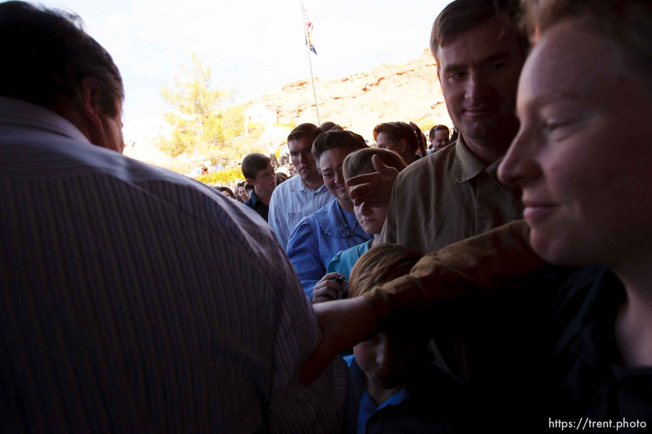 St. George - FLDS members outside the courthouse. A hearing at the 5th district courthouse Friday November 14, 2008 on the proposed sale of UEP trust land including Berry Knoll, a site the FLDS say has religious value, was continued after the attorney general's office stepped in and pressured both sides to seek a settlement. Willie Jessop leaves, shaking hands