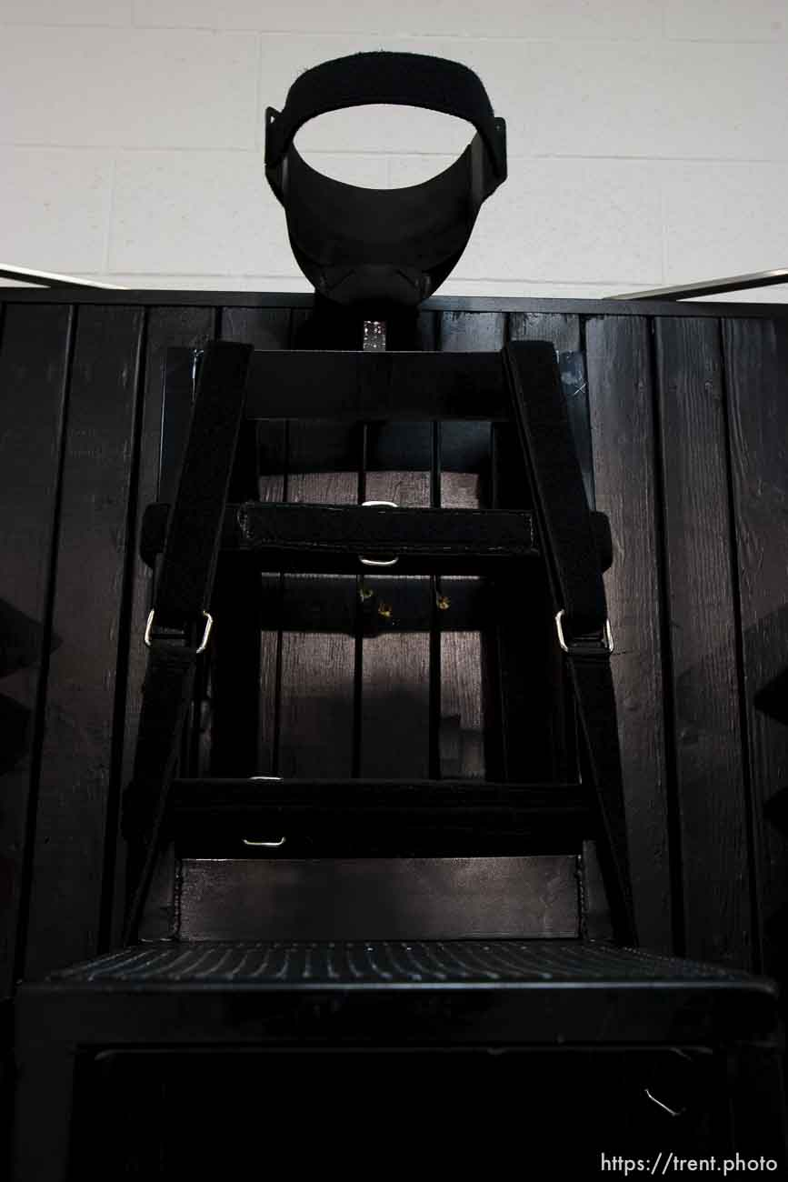 Trent Nelson | The Salt Lake Tribune Draper - The execution chamber at the Utah State Prison after Ronnie Lee Gardner was executed by firing squad Friday, June 18, 2010. Four bullet holes are visible in the wood panel behind the chair. Gardner was convicted of aggravated murder, a capital felony, in 1985.