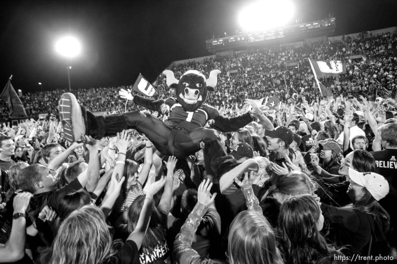 Trent Nelson | The Salt Lake Tribune Utah State's mascot Big Blue surfs a crowd of fans who rushed the field as time ran out and Utah State defeated BYU 31-16. Utah State vs. BYU college football in Logan Friday, October 1, 2010.
