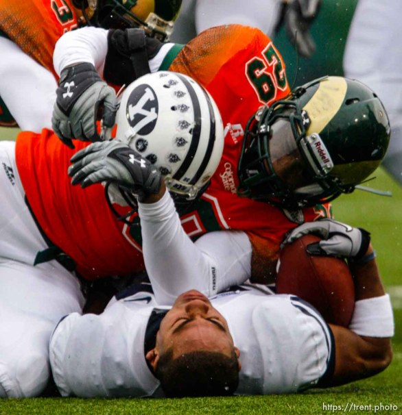 Trent Nelson | The Salt Lake Tribune Colorado State's Broderick Sargent pulls the helmet off BYU running back Joshua Quezada (20) during the second half. BYU vs. Colorado State, college football, Saturday, November 13, 2010. BYU won 49-10.