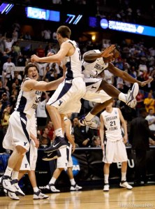 BYU's Jimmer Fredette, Kyle Collinsworth and Charles Abouo celebrate as BYU defeats Gonzaga in the NCAA Tournament, men's college basketball at the Pepsi Center in Denver, Colorado, Saturday, March 19, 2011, earning a trip to the Sweet 16.