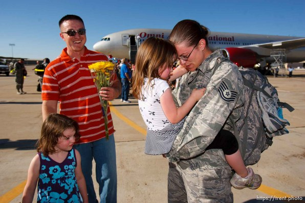 Trent Nelson | The Salt Lake Tribune Tech Sergeant Laura Wright, right, holds her daughter Alexis while her husband Shane and daughter Katie wait their turns as the 729th Air Control Squadron returned to Hill Air Force Base in Layton, Utah, after six months in Afghanistan Wednesday, July 20, 2011.