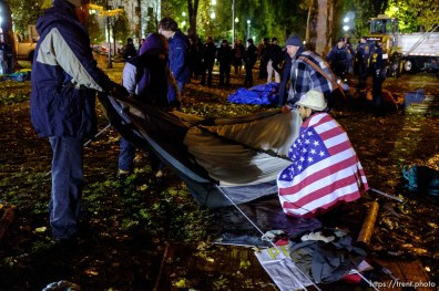 Trent Nelson | The Salt Lake Tribune Activists and homeless packed up their tents as Salt Lake City police cleared the Occupy Salt Lake tent city from Pioneer Park in Salt Lake City, Utah, Saturday, November 12, 2011. jesse fruhwirth wrapped in flag