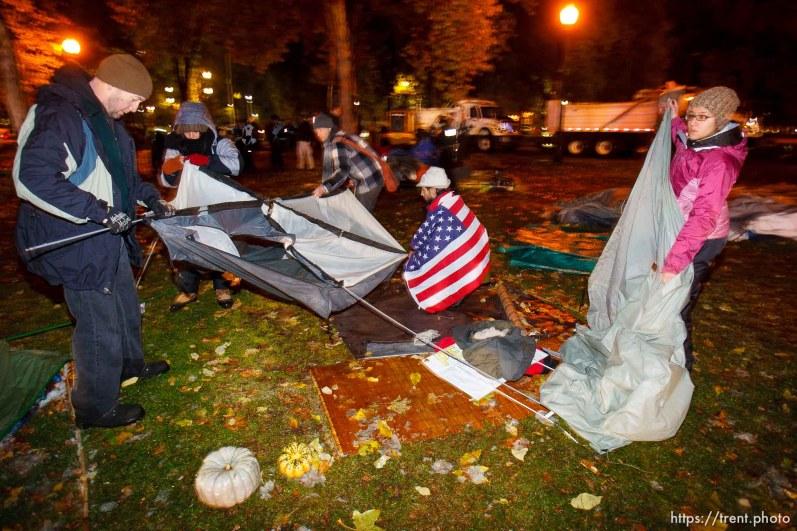 Trent Nelson | The Salt Lake Tribune Salt Lake City police cleared the Occupy Salt Lake tent city from Pioneer Park in Salt Lake City, Utah, Saturday, November 12, 2011. jesse fruhwirth in flag